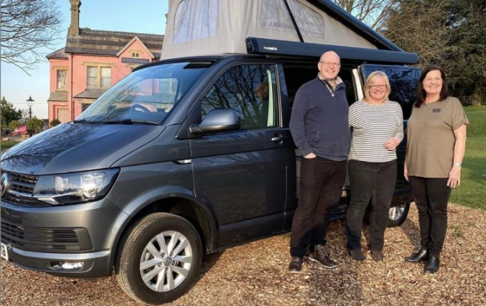 Tribe Campers customers collecting their Volkswagen T6 camper van which is finished in Indium Grey metallic.