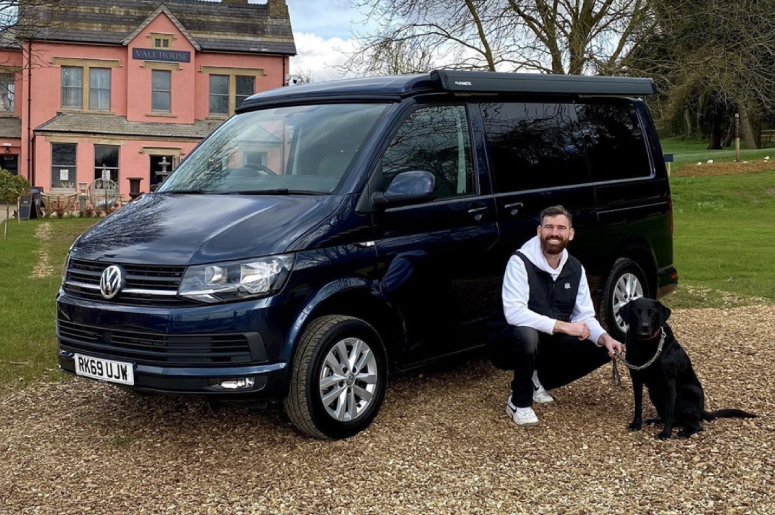 Tribe Campers starlight blue metallic vw camper van being handed over with the customers dog, Oscar. At the Engine Yard, Belvoir Castle.