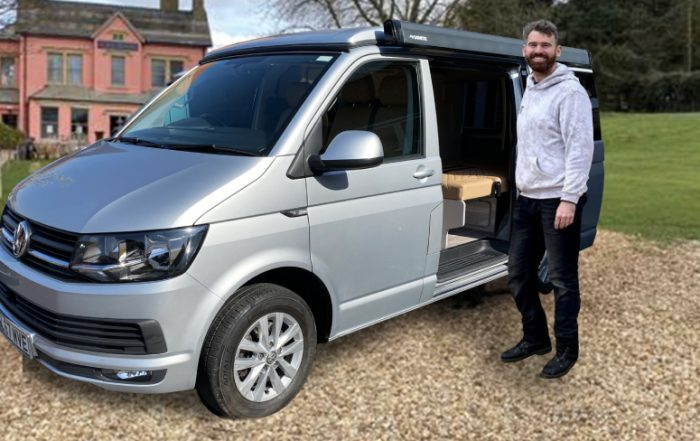 James delivering VW camper van to customer at Belvoir Castle